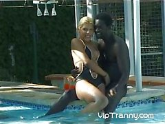 Blonde tranny sucks gigantic black prick and gets fucked outdoors