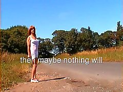 T-girl walks along the road in her undies