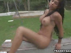 Shemale babe Bruna Rodrigues masturbating outdoors