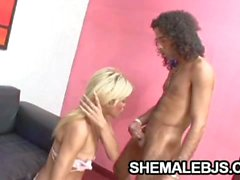 Shemale strokes his cock and gives a blowjob