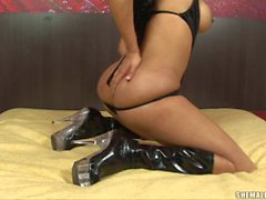 Hot ass brunette shemale in boots does striptease on bed