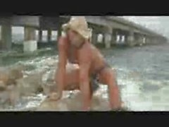 Beautiful Muscle Girl Model flexing and posing on the beaches.wmv