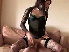 Guy fucks a cute shemale in stockings