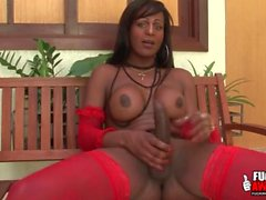 Big cock black shemale strokes her dick