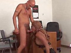 Interracial office sex with a tempting tranny