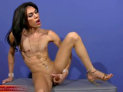 Brunette doll with balls strokes monstercock with both hands