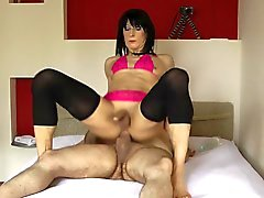 Lingeried crossdresser rides with a delight