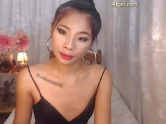 Asian Slim Shemale teasing on webcam