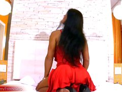 Mature shemale strips red dress and reveals bigtits and dick