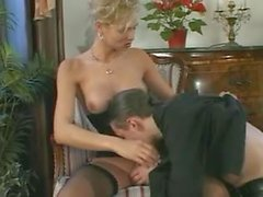 Cool blonde tranny gets fucked on the arm-chair