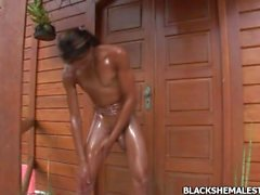 Slender and sexy Brazilian black shemale uses big masculine cock
