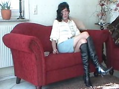 CD in shoes wanking on the sofa